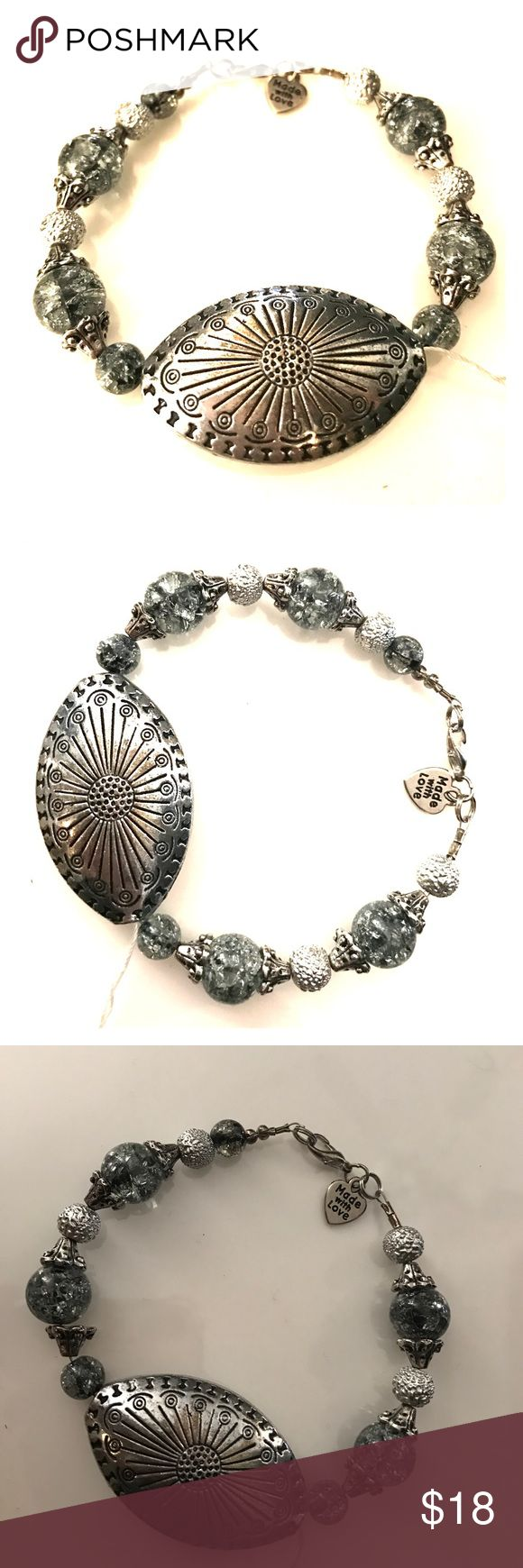 """Plus size handmade focal bead bracelet size 9"""" This bracelet is handmade. The glass beads are the grey beads. Large metal focal bead. Double crimped and made with high quality strands for durability. Measures approximately 9."""" Bundle with other items in my closet to save even more. Jewelry Bracelets"""