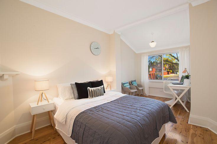 King-size main bedroom, adjacent study/sunroom, desk, sitting chair, bedside tables, lamps, Pilcher Residential