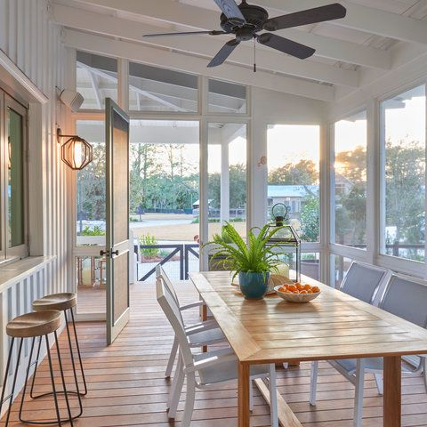 A screened-in dining porch in a contemporary Lowcountry home.