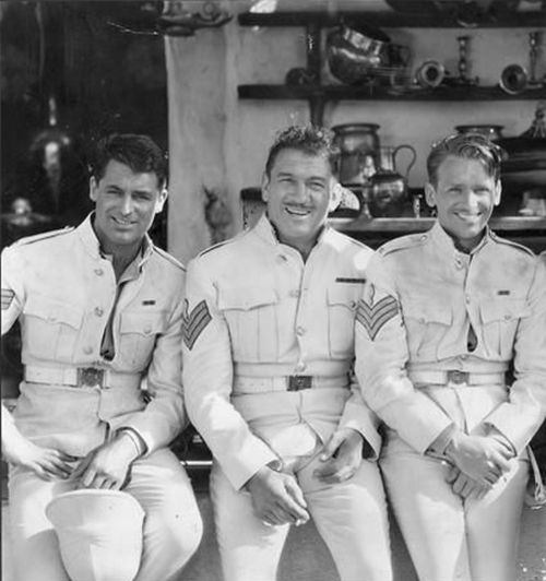 "Cary Grant, Victor McLaglin and Douglas Fairbanks on the set of ""Gunga Din"", (1939)."