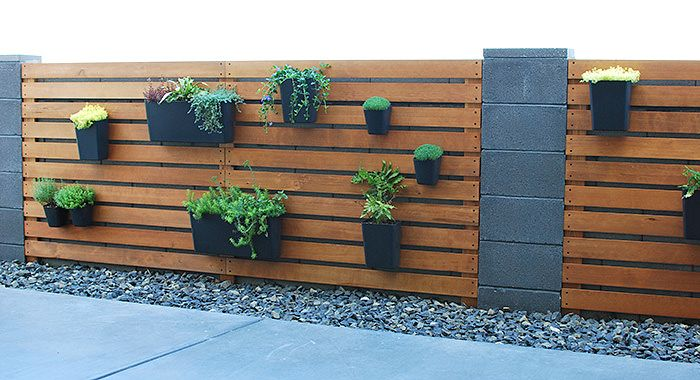 Diy Wood Slat Planter Wall Over Cinder Block Fence The Garden Glove Featured On Remodelaholic In 2020 Cinder Block Garden Wall Garden Wall Garden Wall Designs