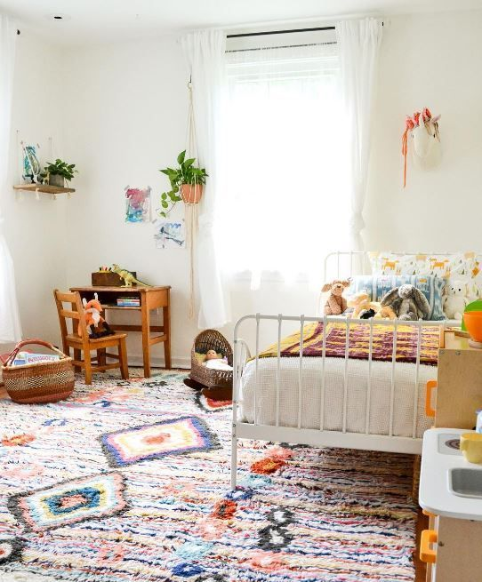 Colorful kids bedroom. Pops of color and white bed frame make this modern style such a cute idea for your kiddos.