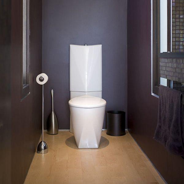 Dark Bathroom With A Modern Toilet Design And A Deep