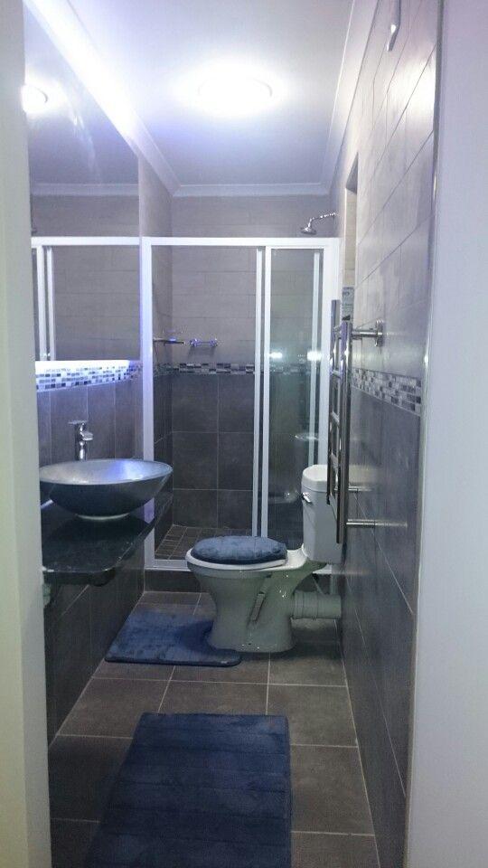 En suite bathroom. Heated towel rack and shower fittings from EPS Plumbing Supplies in Newton Park.