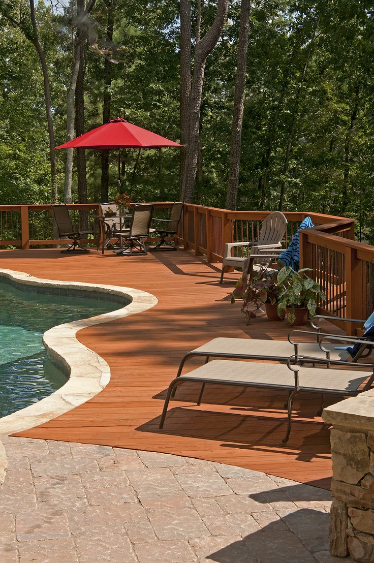 Wood deck adjoining an inground pool. Designed and built by Atlanta Decking.