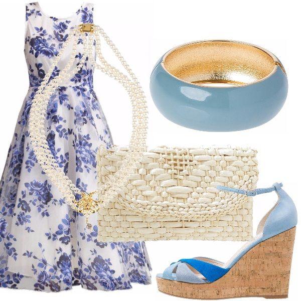L'abito bianco a fiori blu e azzurri ampio è davvero bon ton. Abbiniamo, appunto, una cascata di perle multifilo di color bianco. L'abito andrà indossato di mattina e quindi abbiniamo una borsa a mano lavorata in paglia bianca, delle zeppe azzurre e turchesi e un bel bracciale di color azzurro indaco rigido.