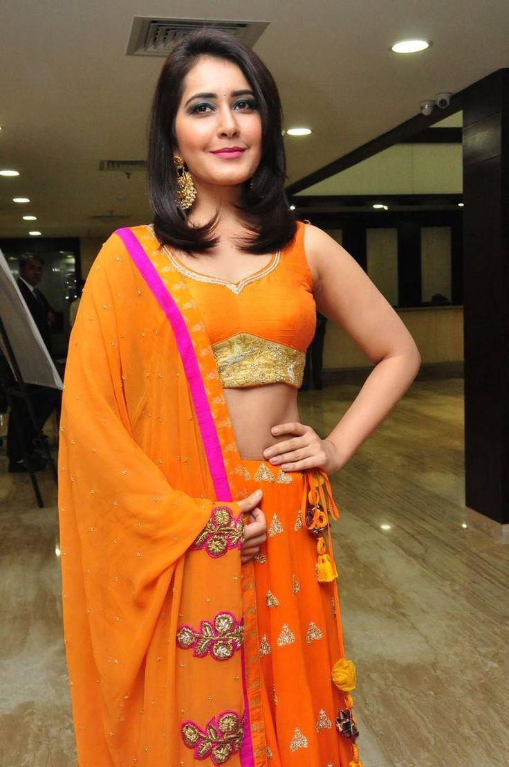 Rashi Khanna Latest Hot Stills In Orange Dress