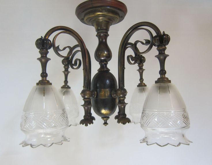 English four arm close fitting ceiling light in the original patinated brass finish, complete with wooden ceiling pattress.  www.antiquelightingcompany.com