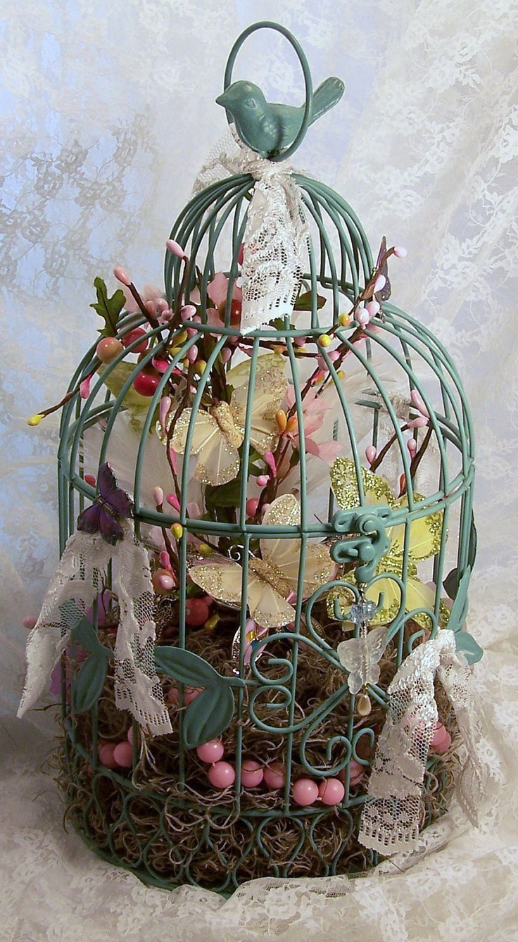 Butterfly Birdcage Shabby Chic Floral Arrangment with butterflies, lace, pearls, feathers and flowers. $75.00, via Etsy.