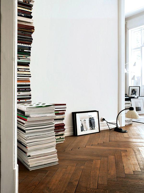 Herringbone wood floor. Floor-to-ceiling magazine stack. B L O O D A N D C H A M P A G N E . C O M:
