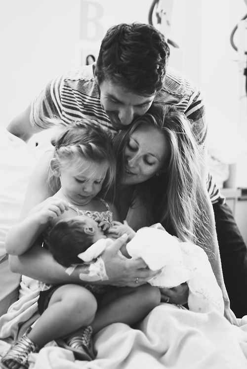 Love this newborn shot with its new family... great moment captured... makes you feel like your part of a sweet moment in their lives.