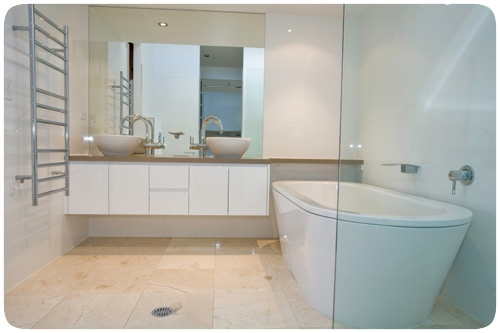 I am thinking of the simple mounted mirror and I like the towel rails with lots of space to give the towels a chance to get dry