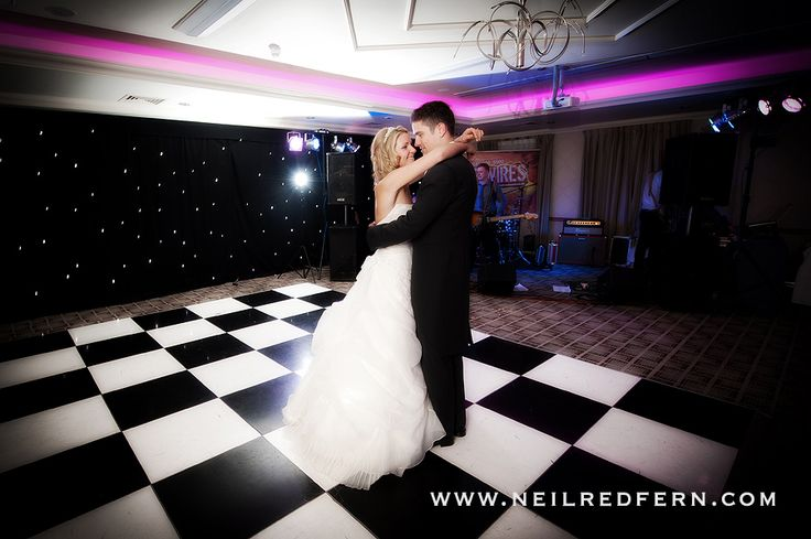 Black and White Chequered Dance Floor with fairy lights back drop creates a stunning backdrop for a first dance. A real wedding at Cottons Hotel & Spa, Knutsford, Cheshire.