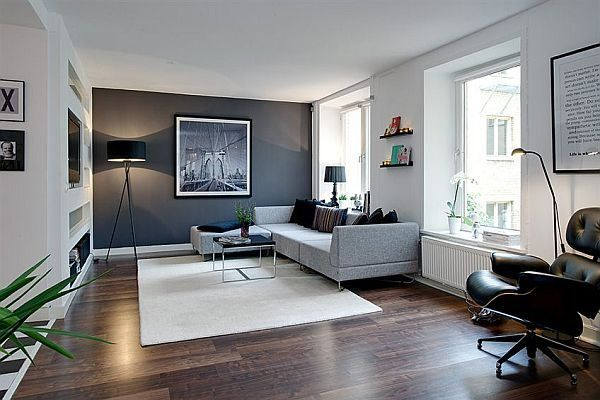 Charcoal accent wall with all white/neutral living room... same color in bedroom and media room/bar