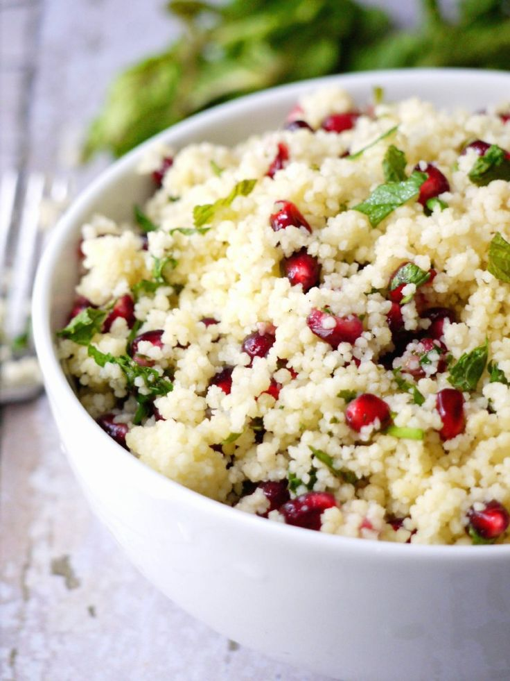 Yellow Couscous with Pomegranate and Mint Citrus Dressing. This is the perfect summer salad. It's light and citrusy and can be eaten hot or cold. It's #dairyfree and #vegan and can be thrown together in under 10 minutes.