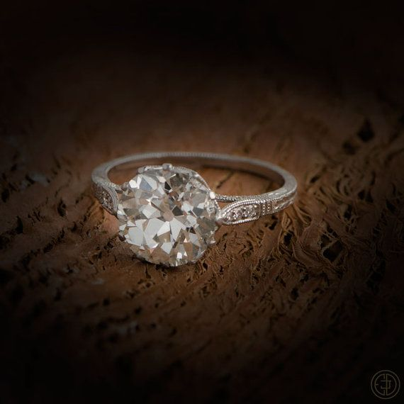 Classic engagement ring set in platinum and diamond mounting. Center diamond is an old European cut weighing approximately 2.90ct, J color,