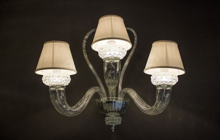 Leucos AURELIANA design by Centro Stile Wall lamp, blown and handmade glass, transparent. Structure in silver.