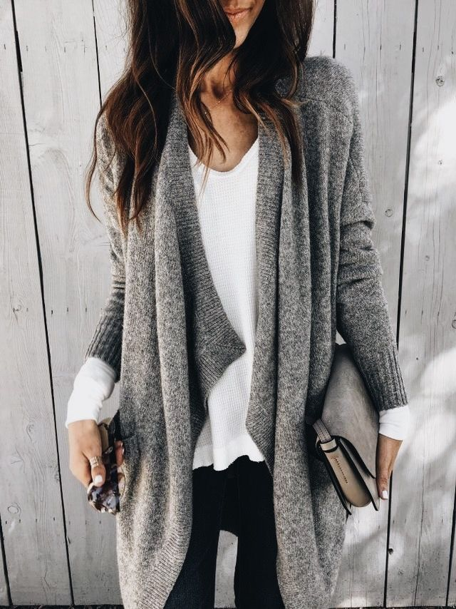 Gray cardigan over white top and black jeans.