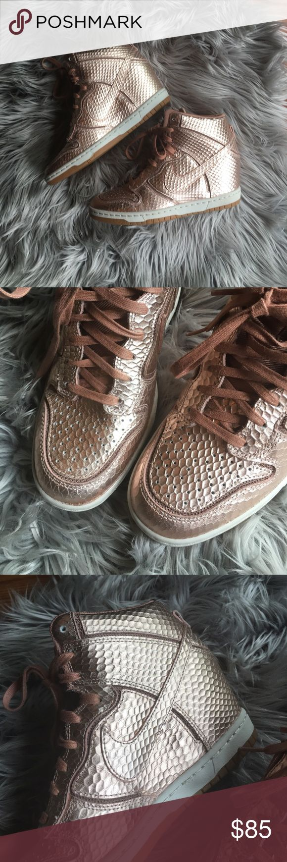Nike Sky Hi Dunk Rose Gold Wedges Such awesome shoes Hi top style with a built in wedge. Worn once, near perfect condition. There is a tiny bit of wear on the back of one of the shoes (please see last picture) but you wouldn't notice unless you were looking for it.  Open to offers  Nike Shoes Sneakers