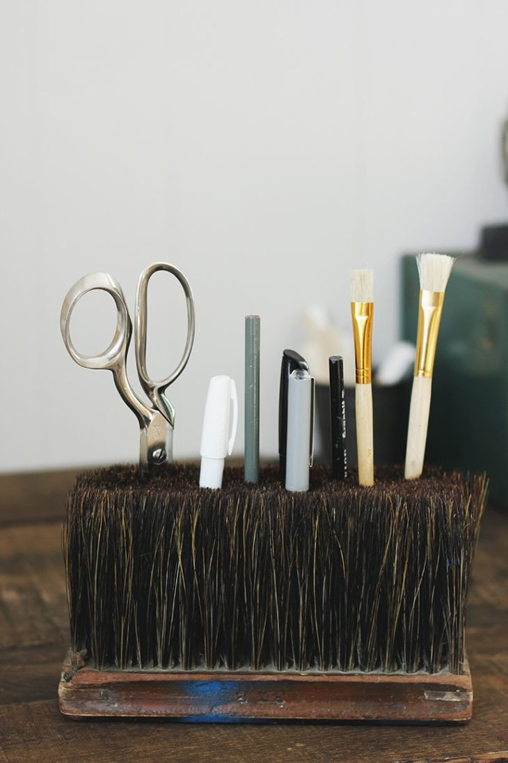 "Keep pencils, brushes and other small items in<a href=""http://themerrythought.com/diy/diy-broom-head-desk-caddy/"" target=""_blank"">The Merry Thought</a></strong>"