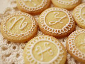 icing cookies with monogram. Lemon cookies perhaps?