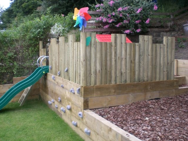Side view of the play area by RB Building and Landscaping; one way to deal with our slope
