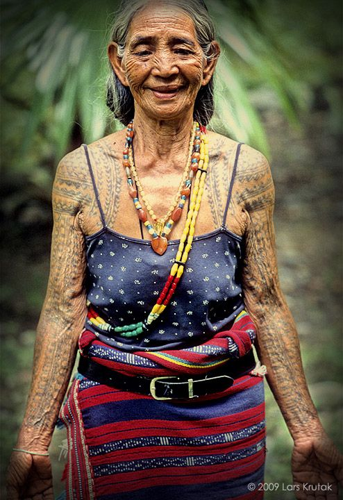Philippines | Kalinga woman; heavily tattooed arms and beaded bodies make for timeless beauty. | © Lars Krutak