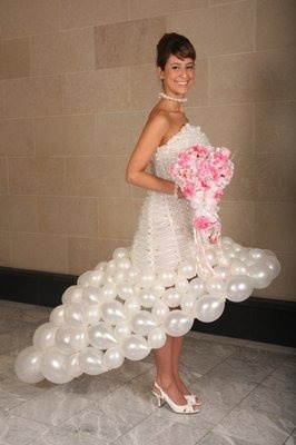 Guaranteed not to wrinkle. This dress was created for WE-tv's 2010 Wedding Mall Tour, and took about 24 hours to make. We're not sure if the necklace is made up of tiny balloons, too, but if it is, that's pretty cool.