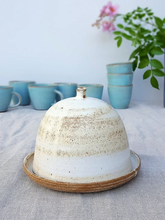 Ive first made this dish as a custom order for a client. It turned out so lovely so Ive decided to add it to my shop regularly. This rustic earthy style ceramic butter dish is great for storing and serving butter and keeping it cool and fresh. Beautiful to serve at the table during breakfast or dinner and great for storing in the fridge.  To get this soft smooth look, I use dark clay and apply white porcelain slip with a brush. I then glaze it with a matte off white glaze.  ✈ Ready to ship…