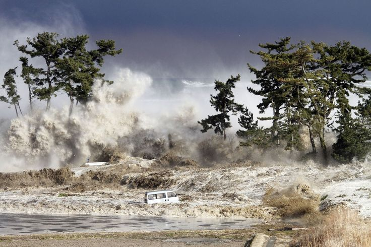 Tsunami waves hit the coast of Minamisoma in Fukushima Prefecture, photographed on March 11, 2011 by Sadatsugu Tomizawa and released via Jiji Press on March 21, 2011.