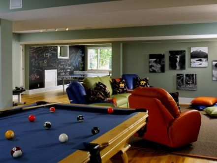 Designer Susan Fredman incorporated the colors in the pool balls throughout this room within the furniture and accessories, which turn this space into a playful area for the whole family to enjoy.