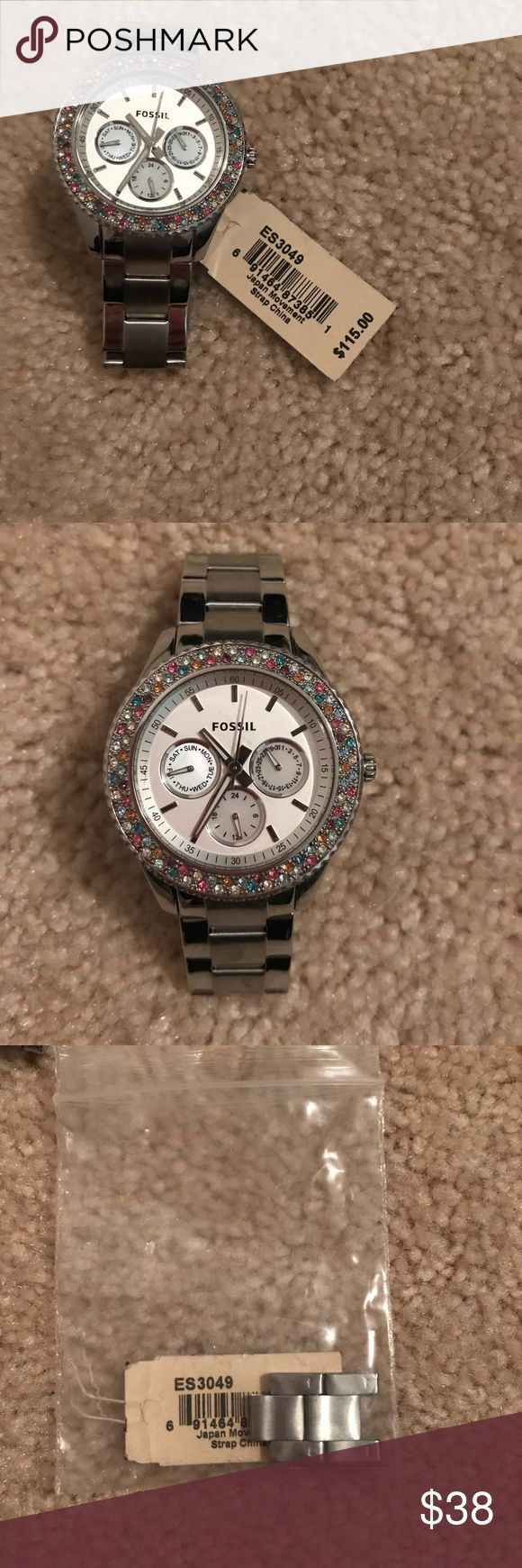 Fossil watch Multicolored rhinestone fossil watch Had it sized but never wore it.  Still have tag and pieces to make it larger.  Needs new battery Fossil Accessories Watches