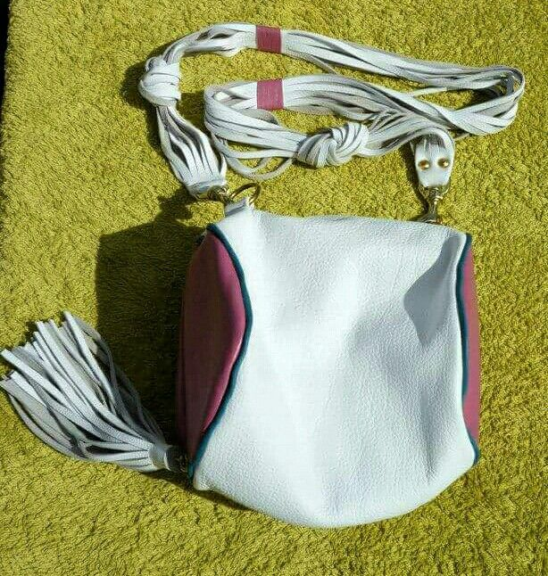 Handmade leather cylindrical shoulder bag in white with pink and turquoise hints