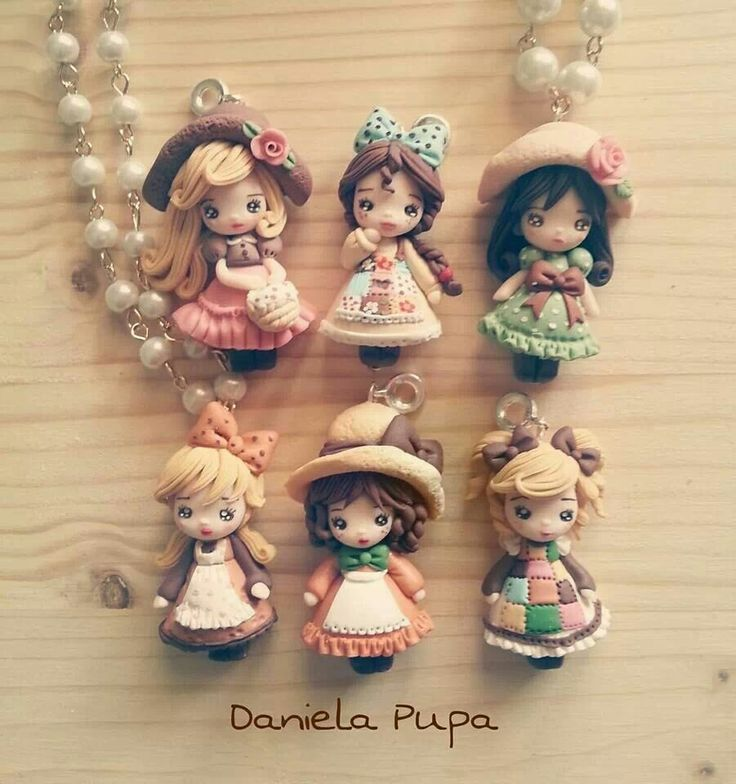 These pretty girls are some of the most beautiful clay creations I have ever seen. The details are amazing.