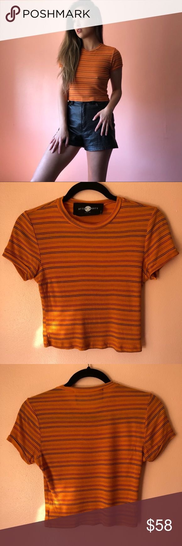 Nasty Gal After Party Orange Stripe Tee Hang with the dudes in this orange striped tee by After Party by Nasty Gal. Features a crew neck, short sleeves, slightly cropped fit in a lightweight rib vintage fabric. Wear with denim. Fits like an XS-S. Marked size S. No returns allowed. Please ask all questions before buying. Follow IG: [at] jacqueline.pak for sneak peeks, first dibs, giveaways and discount codes. #nastygal #vintage Nasty Gal Tops Tees - Short Sleeve