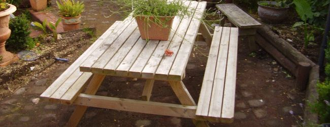 A solid traditional type picnic table
