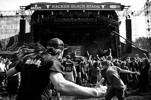 go to Wacken open air to expierence a heavy metal music festival. the power and good times is why i would do it.