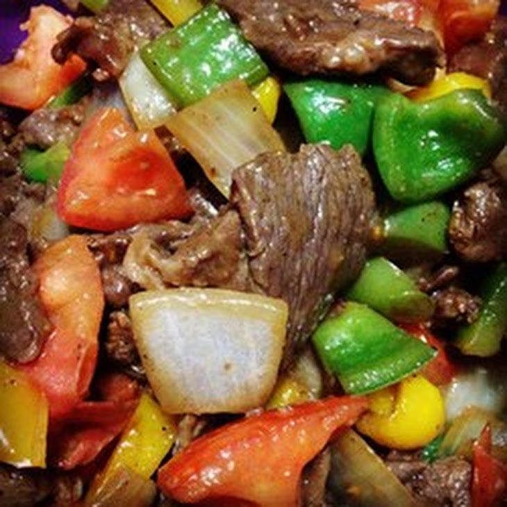 Chinese Pepper Steak Recipe Main Dishes with top sirloin steak, soy sauce, white sugar, corn starch, ground ginger, vegetable oil, purple onion, green bell pepper, tomatoes