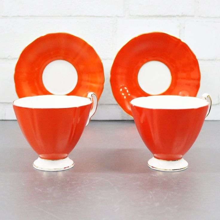 Beautiful and rare Orange Teacup And Saucer Set For 2 from Ridgeway Potteries in the very elegant Royal Adderley pattern. Both the orange tea cups and saucers are scalloped and have a gold rim. It is a stunning set and will make an excellent bridal gift.