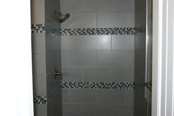 Stripe Of Small Tiles Going Around The Walls Gray And