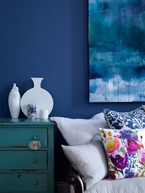 dark blue walls with turquoise chest of drawers and white sofa - #designsponge