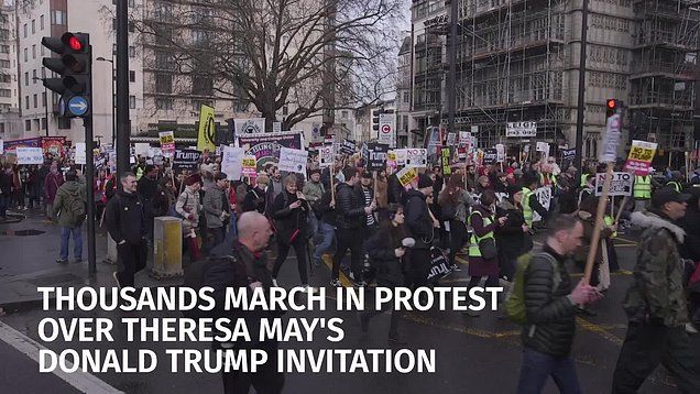 "Demonstrators urged the prime minister to withdraw her controversial invitation of a state visit to Mr Trump and denounced his travel ban as ""racist""."