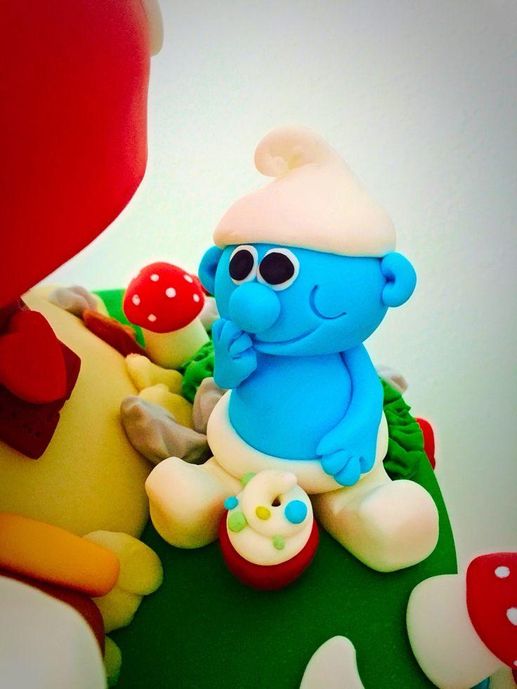 Cute smurf on birthday cake