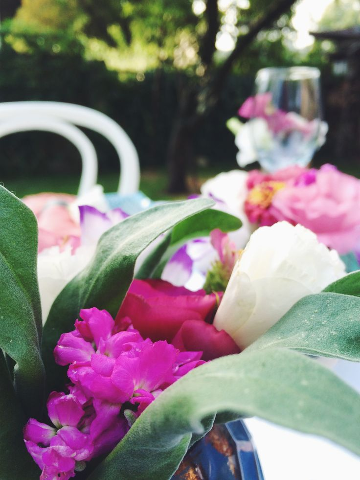 Dinner in the garden. Fresh flowers and wine glass.