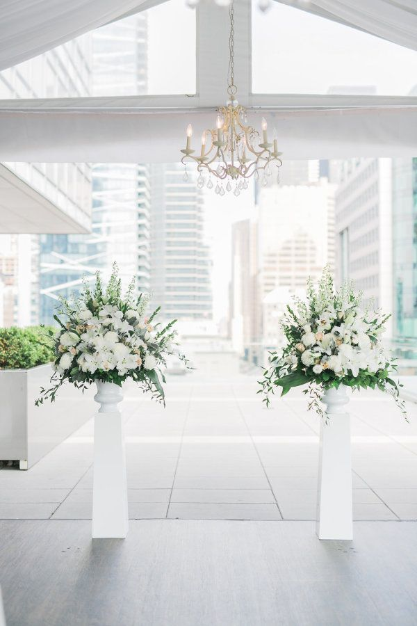 Beautiful white wedding flowers: http://www.stylemepretty.com/canada-weddings/ontario/toronto/2016/08/11/romantic-rooftop-wedding-at-malaparte/ Photography: Rhythm - http://rhythm-photography.com/