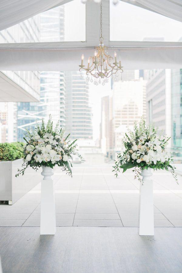 Beautiful white wedding flowers: http://www.stylemepretty.com/canada-weddings/ontario/toronto/2016/08/11/romantic-rooftop-wedding-at-malaparte/ Photography: Rhythm - http://rhythm-photography.com/