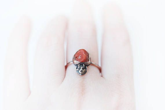 This is a solid bronze, coral and copper ring made in my studio. The little devil used to be part of a tiny jack in the box, from around the Victorian or Edwardian era. I made a replica of the little devil to give it new life in this ring design cast out of solid bronze! The red mediterranean coral is vintage, it used to be part of an italian necklace! The copper setting of the coral is freeform to match it. The ringband is solid copper. I made the ring to look vintage and rustic with patina…