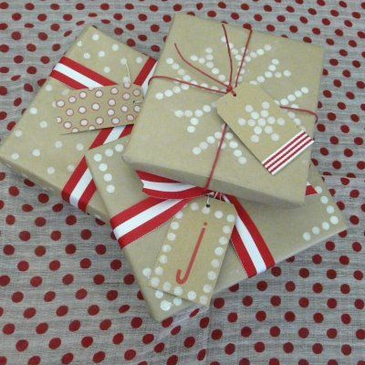 christmas gift wrap stamped with a pencil eraser Genius!