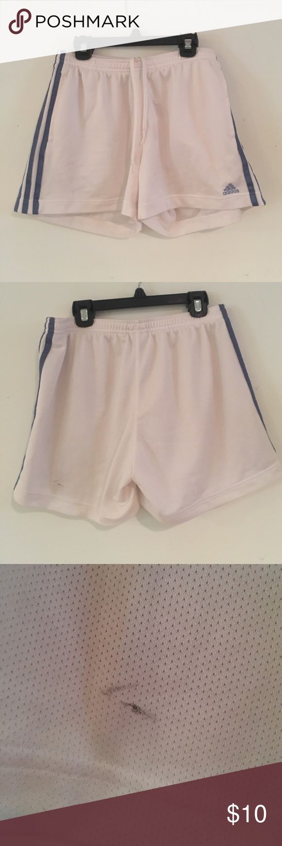 Adidas soccer shorts size m White with nautical blue adidas lines. Size m. In well loved condition. Has a little black eyeliner on the back of the left side. Perfect condition besides for that. Does not have inside liner. Adidas Shorts