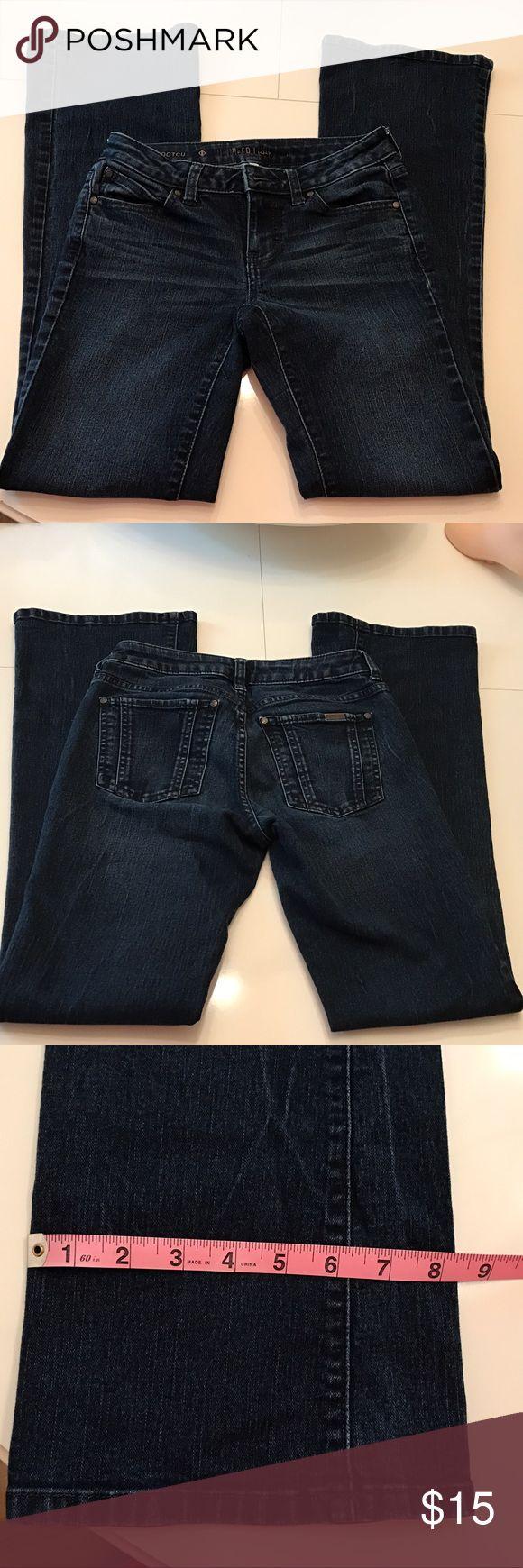 """Jennifer Lopez boot cut jeans. Size 0. Jennifer Lopez dark wash boot cut jeans. Size O. 31"""" inseam. In EXCELLENT shape. No reasonable offer refused. Jennifer Lopez Jeans Boot Cut"""